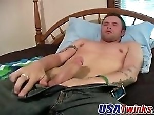 Tattooed twink with big strong dick wanking it hard for you